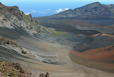 Haleakala Crater viewed from the summit Visitor Center. The gray linear features extending downslope into the summit basin are debris trains and active slides, fine-grained material actively creeping downslope.
