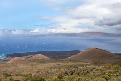 The view of Ahihi Kinau Natural Area Reserve (darker ground along the shoreline), Pu'u o Kanaloa (a cinder cone in Haleakala's Southwestern Rift Zone), and the island of Kaho'olawe (on the horizon). Photo taken at Ulupalakua, south Maui.