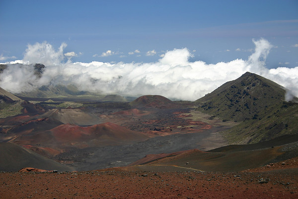 Clouds encroaching on the eastern rim of the crater rim and the Haleakala Summit Basin. Haleakala National Park, south Maui.
