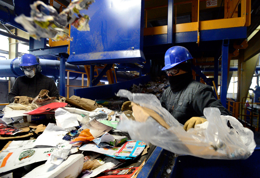 . BOULDER, CO - FEBRUARY 22, 2019  Workers at the main inflow line presorts out trash, plastic and scrap metal at the Boulder County Recycling Center on Friday February 23, 2019 in Boulder on Friday. The center has been able to expand its presorting staff.  Paul Aiken / Staff Photographer
