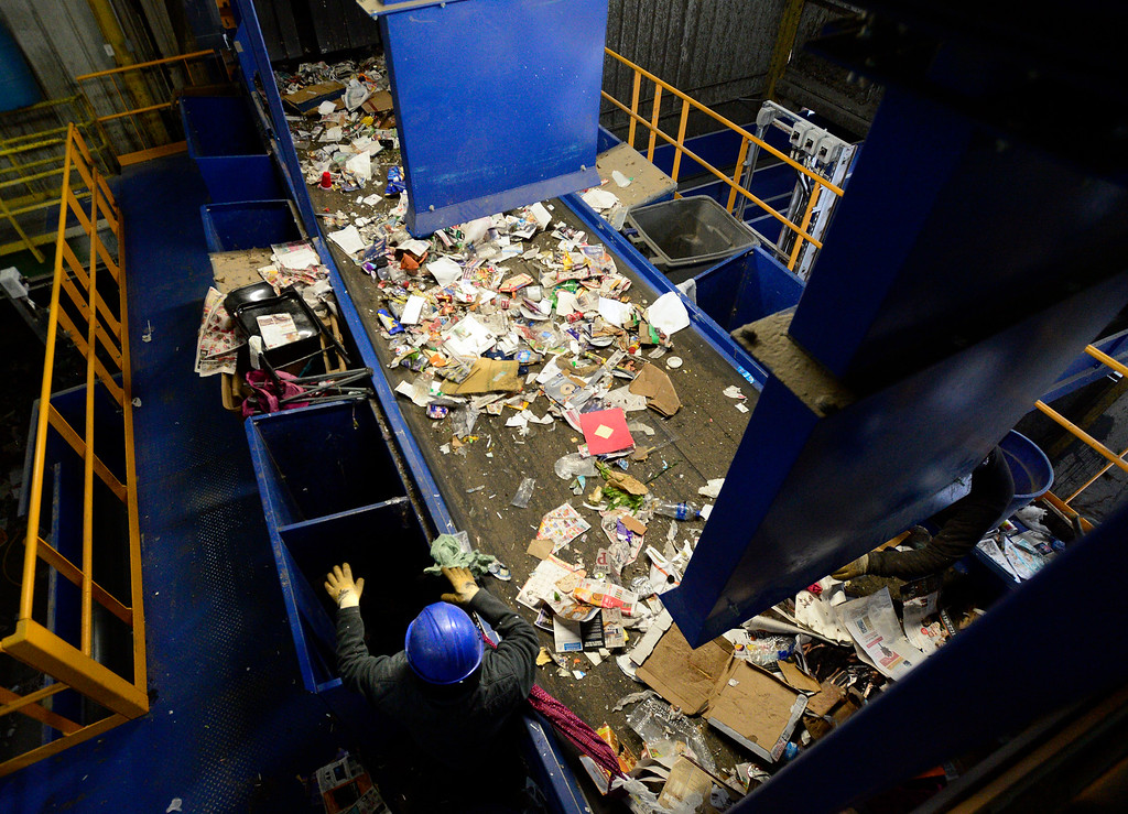 . BOULDER, CO - FEBRUARY 22, 2019  A worker at the main inflow line presorts out trash, plastic and scrap metal at the Boulder County Recycling Center on Friday February 23, 2019 in Boulder on Friday. The center has been able to expand its presorting staff.  Paul Aiken / Staff Photographer