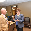 Dr. Sherry Labyer demonstrates the triple option to Duncan's new HS football coach. <br /> <br /> Photographer's Name: Steve  Olafson<br /> Photographer's City and State: Duncan, OK