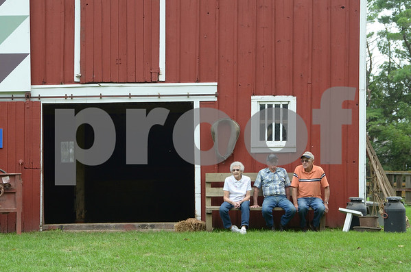 -Messenger photo by Jesse Major<br /> From left, Bobbie Nilles, Harold Nilles and Arnold orkelson, sit outside a barn during Wiegert Prairie Fallfest on Sunday.