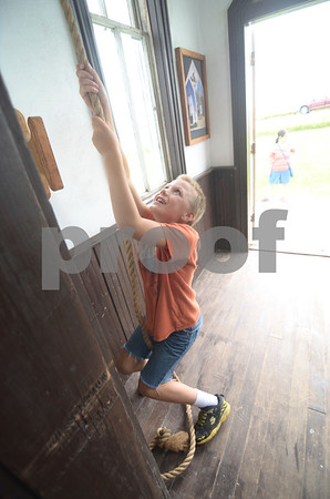 -Messenger photo by Jesse Major<br /> Gabriel Coon, 9, of Fonda, rings the bell at Pioneer Church during Wiegert Prairie Fallfest on Sunday.
