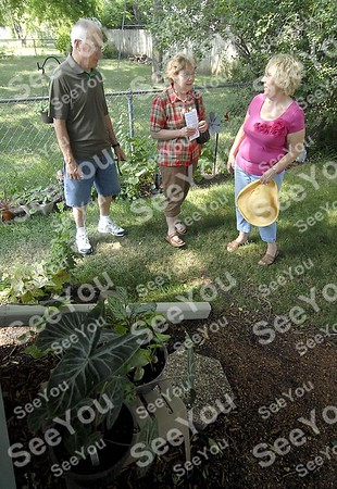 -Messenger photo by Hans Madsen<br /> <br /> Don and Judy Touney, of Fort Dodge, stop to visit with Karen Johnson Saturday morning as they look through her garden on the 11th annual Fort Dodge Federated Garden Club garden tour.