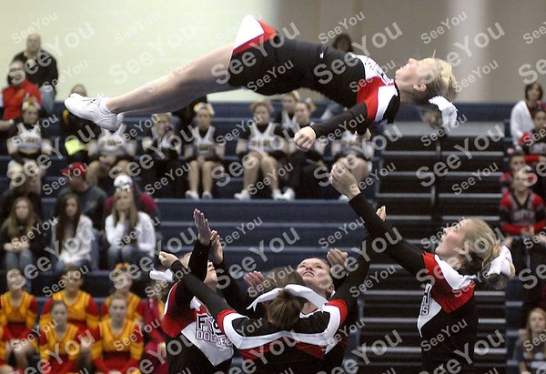 -Messenger photo by Hans Madsen<br /> <br /> Fort Dodge Senior High School cheerleader Lexi Wilcox begins coming back down Saturday morning during competition in the large stunt-team division at the Triton Cheerleading Challange held at Iowa Central Community College.