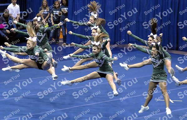 -Messenger photo by Hans Madsen<br /> <br /> Members of the St. Edmond High School cheerleader squad leap into the air Saturday morning during their routine at the Triton Cheerleading Challange at Iowa Central Community College.