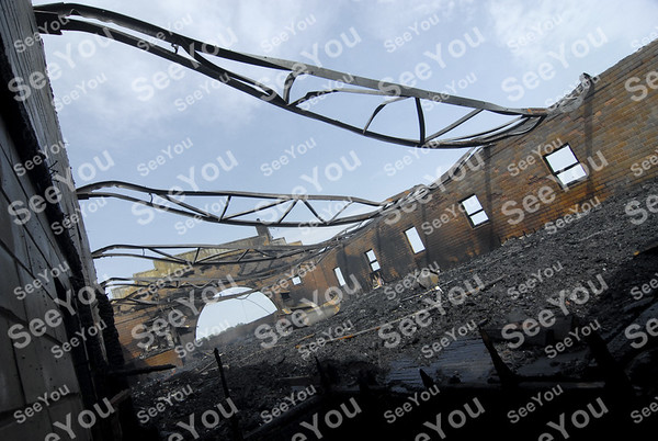 -Messenger photo by Hans Madsen<br /> <br /> Twisted steel roof beams hang in silent testimony to the heat and intensity of the Friday night fire that destroyed most of the historic Bohemian Hall located at 2601 Johnson Ave.
