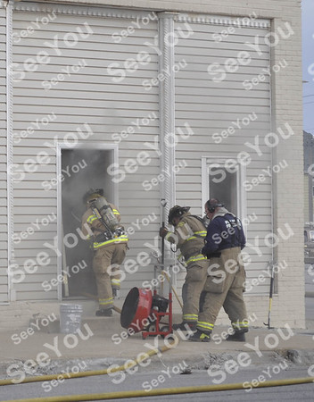 - Messenger photo by Peter Kaspari<br /> <br /> Fort Dodge firefighters prepare to enter the building at 125 S. Fourth St. Monday afternoon to extinguish a fire. According to Tim Simmons, owner of Tim Simmons Enterprises, which is located in the building, the fire was first noticed by a worker who was staining a door. The fire quickly expanded and the Fort Dodge Fire Department was called. Fire Chief David Luers said there was extensive damage to the business, and an apartment upstairs. Nobody was in the building when the fire began, and no injuries were reported. An ambulance from Trinity Regional Medical Center and officers from the Fort Dodge Police Department responded.