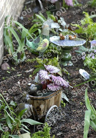 -Messenger photo by Hans Madsen<br /> <br /> A new section of Karen Johnson's garden contains a whimsical ant pushing a cart with a flower in it.