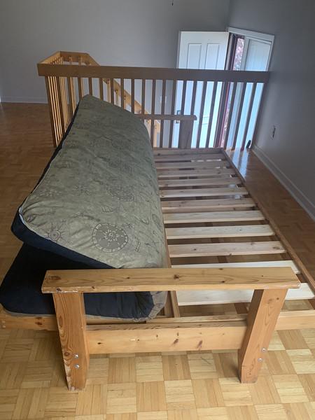 Futon structure --  reversible mattress folded back.