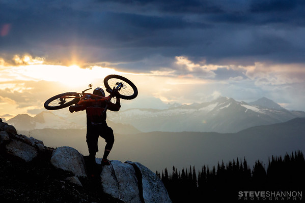 Athlete: David Pearson<br /> Location: Revelstoke, BC<br /> The alpine is a way of life in Revelstoke, but it's not always easy.  Dave shoulders his bike and heads for the summit.