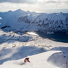 Robert Stoeckel slashes some May powder on his way down to Siglufjordur on Iceland's Troll Peninsula.  This line ended an 1800m ski touring day traversing three fjords from Olafsfjordur to Siglufjordur.