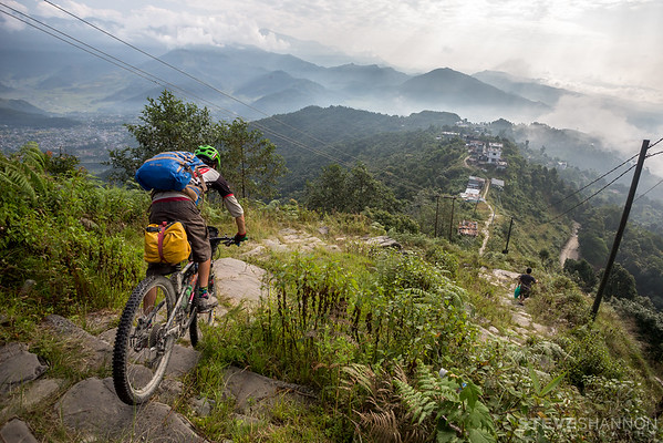 After arriving in our final destination of Pokhara, we went for a quick overnight mission up to Sarangkot to catch the sunrise over the Annapurna region.  My rear derailleur exploded on the ride up and unfortunately I had left the spare in Pokhara, so I detoured from the rest of the group and hiked up this staircase.  The following morning after watching the sunrise we began our descent back to Pokhara and after having to push along the flat portions of the road, I said screw it and Todd and I headed for the fun way down.  Nothing in Nepal is built consistently, including these stairs.  You never knew who big of a drop each stair would be, and some were definitely more than we bargained for.  The locals gave us crazy looks but it was some of the most fun we had.  Part way down the stairs I saw this cool scene and had to stop to get a photo of Todd blasting down.