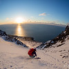 Emelie Stenberg skiing a couloir in Northern Iceland above the Greenland Sea.