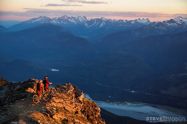 Athlete: Luke Stevens & Ted Morton<br /> Location: Revelstoke, BC<br /> The sun sets over the Monashees while Luke and Ted enjoy the view.