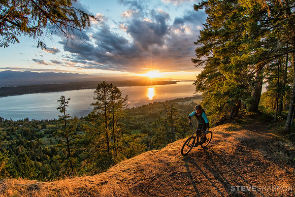 Trail: Cliff Trail<br /> Location: Hornby Island<br /> Rider: Kelsey Thompson<br /> What kind of island life would it be without incredible sunsets?  Hornby certainly delivers, and the Cliff trail definitely wins for the best spot to watch the sun fade away.  Follow it up with a wicked descent down any number of the trails and it's tough to beat!<br /> What kind of island life would it be without incredible sunsets?  Hornby certainly delivers, and the Cliff trail definitely wins for the best spot to watch the sun fade away.  Follow it up with a wicked descent down any number of the trails and it's tough to beat!<br /> What kind of island life would it be without incredible sunsets?  Hornby certainly delivers, and the Cliff trail definitely wins for the best spot to watch the sun fade away.  Follow it up with a wicked descent down any number of the trails and it's tough to beat!