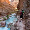 Jeff Strutz exploring the Havasu creek canyon while on a whitewater rafting trip down the Grand Canyon.