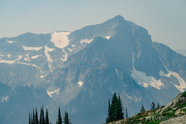 Jessica Taylor ascends towards Caribou Pass with Pride Rock in the background.