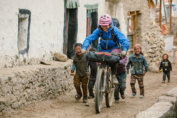 Kathryn Whiteside gets a little help from the local children in Ghami, Nepal.  A small town in the restricted Mustang region, the Tibetan culture was highlighted by interactions with the friendly locals.