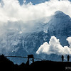 Bikepackers are silhouetted under Nilgiri (7061m).  Mustang, Nepal