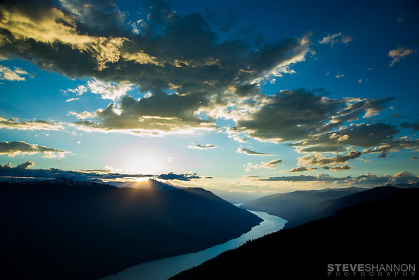 Sunset over Frenchman's Cap in the Monashee Mountains and Lake Revelstoke north of Revelstoke, British Columbia.