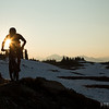 A mountain biker is silhouetted on the Frisby ridge trail during sunset one summer evening.<br /> Athlete: Alex Cooper<br /> Location: Frisby Ridge, Revelstoke, BC