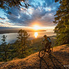 Kelsey Thompson rides the cliff trail on Hornby Island at sunset.
