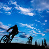 Rylan Kappler and Brody Evans are silhouetted on a clear day at Sol Mountain Lodge.