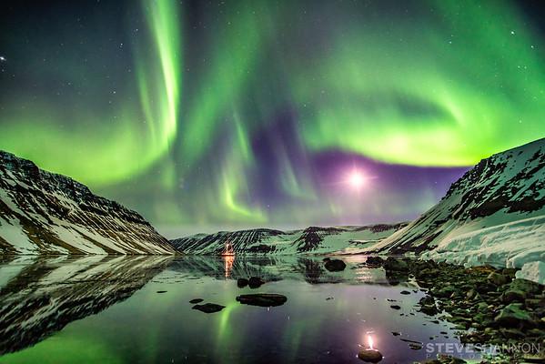 The aurora borealis lights up the night sky above the Aurora Arktika in the Hornstrandir Nature Preserve.