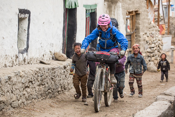 I captured this image of Kathryn late in the day in the town of Ghami on our exit from the Mustang.  After a long day of incredible singletrack we arrived in Ghami only to find all of the tea houses full.  While our guide searched the town to find some locals willing to let us stay for the night, the local kids entertained us by trying to hitch a ride on our bikes as we rode through town.  We did manage to find a place to stay, which turned into the local party spot that night with all of the guides from various tour operators coming over for Rakshi drinks and dancing.  It was probably the funniest night of the trip!
