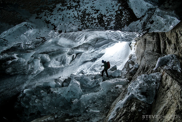Dan Pichette exploring an ice cave at the toe of the Kemmel glacier near Icefall Lodge, British Columbia.