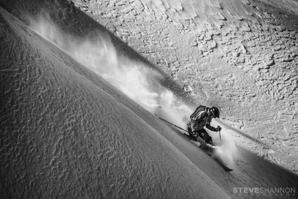 A telemark skier turns through textured powder snow at Selkirk Wilderness Skiing near Meadow Creek, British Columbia.<br /> Model: Russell Williams<br /> Location: Selkirk Wilderness Skiing, BC