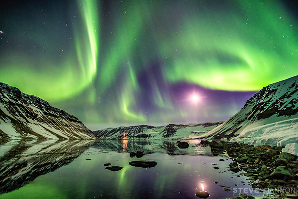 The aurora borealis lights up the night sky above the Aurora Arktika in the Hornstrandir Nature Preserve.
