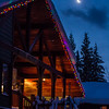 A crescent moon illuminates snowy skis idly awaiting another day of powder skiing at Selkirk Wilderness Skiing near Meadow Creek, British Columbia.