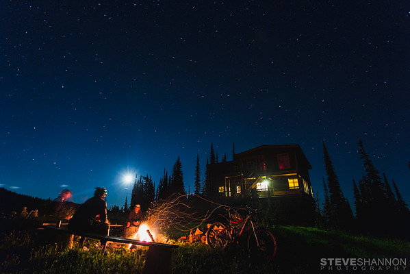 Matt Yaki, Jordie McTavish and Rylan Kappler around the fire after a long day of mountain biking at Sol Mountain Lodge in the Monashee mountains.