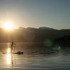 Lindsay Davies stand-up paddleboarding on Lake Revelstoke, BC.