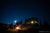 Matt Yaki, Jordie McTavish and Rylan Kappler around the fire after a long day of mountain biking at Sol Mountain Lodge in the Monashee mountains.