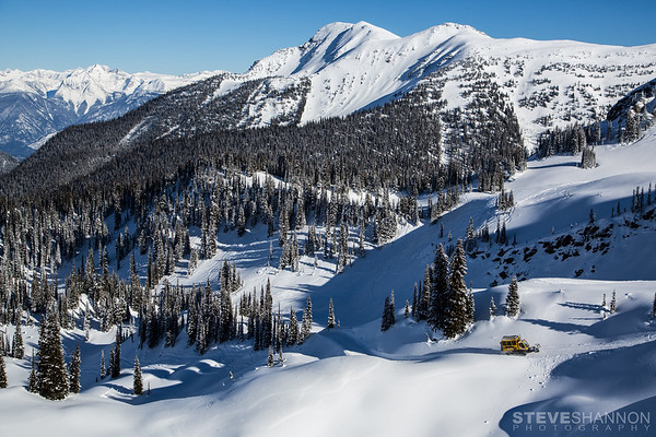 A snowcat takes backcountry skiers up for another powder run at Selkirk Wilderness Skiing near Meadow Creek, British Columbia.