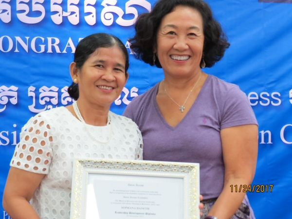 Janice with new A2/Cambodia graduate