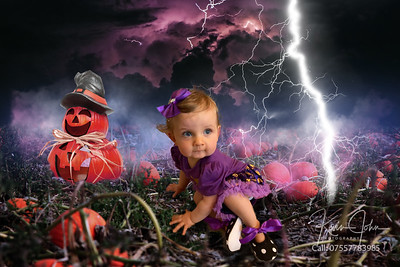 Baby with punpkins