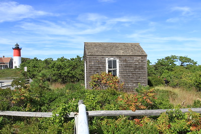 In the foreground is the house where telegraph cable lines came into from Nova Scotia. In the background is Nauset Lighthouse