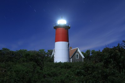 Nauset Light nestled among the Cape's many pine trees.