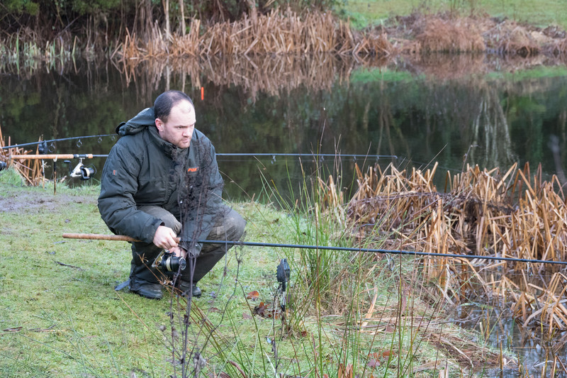 Andrew Moores positions a rod while I have the far corner covered