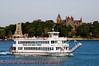 The Uncle Sam Boat Tours' cruiser, the Alexandria Belle, cruising past Heart Island on the St. Lawrence River.