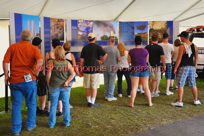 People in the New York Remembers exhibit on 9/11 attack on the World Trade Center on September 11, 2001 at The Great New York State Fair in Syracuse, New York.