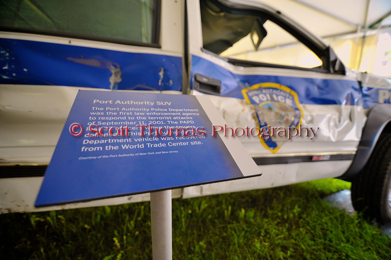 Police vehicle damaged during the 9/11 attack on the World Trade Center in the New York Remembers exhibit at The Great New York State Fair in Syracuse, New York.