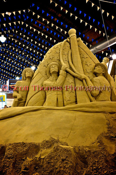 Firemen raising the American flag at Ground Zero is depicted in the sand sculpture inside the Center of Progress building at The Great New York State Fair in Syracuse, New York.