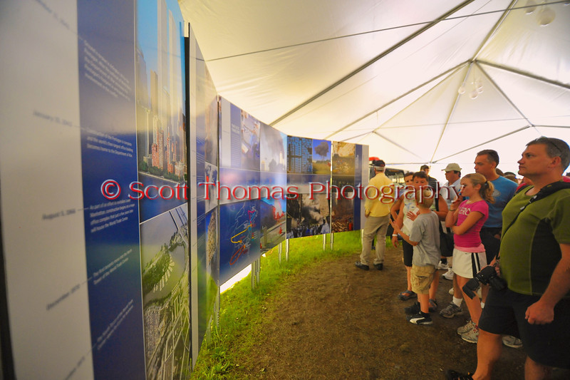 People in the New York Remembers exhibit on the 9/11 attack of the World Trade Center at The Great New York State Fair in Syracuse, New York.