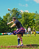 A Highland Games athlete in the Braemar Heavy Stone competition at the Cortland Celtic Festival at the Dwyer Memorial Park in Little York, New York.